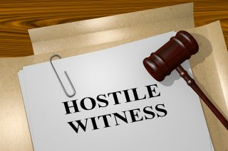 What is a hostile witness in an Illinois divorce?